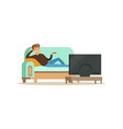 young man sitting on a sofa in a living room in vector image vector image