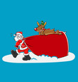 santa and reindeer carrying a big sack vector image