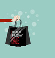 hand with shopping bag in black friday sale vector image vector image