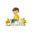 cute little boy in warm clothing sitting on the vector image vector image