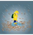 Kid in raincoats and rubber boots in the rain vector image