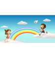 Happy kids near the colorful rainbow vector image vector image