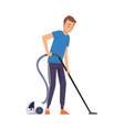 man vacuuming floor household activity