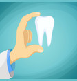 doctor dentist holding a human tooth in his hand vector image