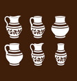 set of ceramic crockery in brown and white colors vector image vector image
