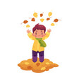 boy throws autumn leaves up isolated vector image vector image