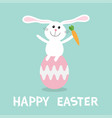 rabbit with carrot sitting on painting pink egg vector image vector image