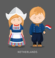 dutches in national dress with a flag vector image vector image