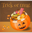 jack-o-lantern candy basket with pile colorful vector image vector image
