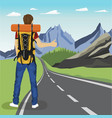 young man doing hitchhiking on road in mountains vector image vector image