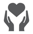 heart in hands glyph icon love and care arms vector image