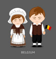 belgians in national dress with a flag vector image vector image