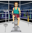 young man on an exercise bike in gym in evening vector image vector image
