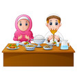 muslim couple pray together before break fasting vector image
