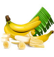 ripe yellow bananas with slices and leaves