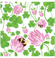 Seamless background with clovers vector image