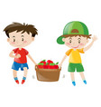 two boys carrying basket full of apples vector image