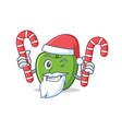 santa with candy green apple character cartoon vector image vector image