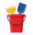 plastic bucket with rake and shovel vector image vector image