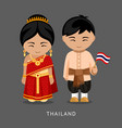 thais in national dress with a flag vector image