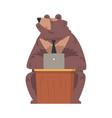 bear businessman working on laptop computer