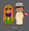 omani in national dress with a flag vector image vector image