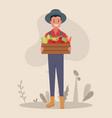 a young farmer at farmers market sells vector image