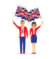 man and woman waving the uk flag vector image vector image