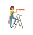 female painter in uniform with paintbrush in hand vector image vector image