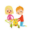 cute little boy and girl cutting application vector image