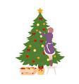 girl decorates christmas tree on white background vector image