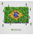 large group of people in the brazil flag shape vector image vector image