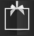 white gift box frame with silky bow on black vector image