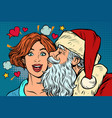 Santa claus kisses a woman christmas and new year