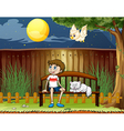 A boy sitting with his cat inside the fence vector image vector image