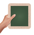 hand holding a slate board vector image vector image