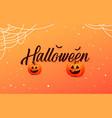 happy halloween calligraphy with pumpkins vector image
