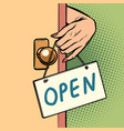 open woman hand hangs a sign on door vector image