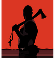 silhouette of a man with a hatchet on a red vector image
