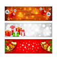 Christmas banners with balls gift boxes and bells vector image vector image