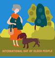 grandmother is walking in the park with her dog vector image vector image