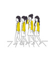 group of women with yellow clothes vector image