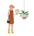 woman with houseplant on macrame hangers vector image vector image
