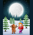little girl playing with a deer in the snowy garde vector image vector image