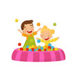 happy boy and girl playing in a ball pit kids on vector image