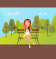 stylish woman sitting in park and using tablet vector image vector image