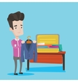Young man packing his suitcase vector image vector image