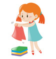 little girl in blue dress folding clothes vector image vector image