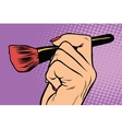 Make-up brush in hand vector image vector image