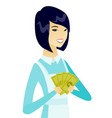 young asian cleaner holding money vector image vector image